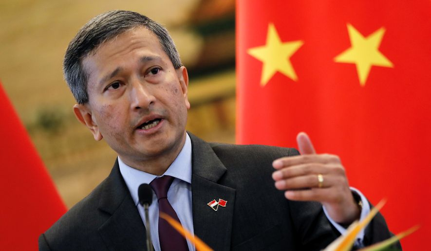Singapore's Foreign Minister Vivian Balakrishnan speaks during a joint press conference with his Chinese counterpart Wang Yi after their meeting at the Ministry of Foreign Affairs in Beijing Monday, June 12, 2017. (AP Photo/Andy Wong)
