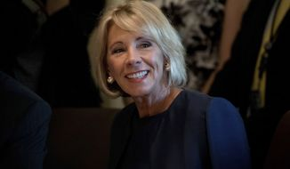 Education Secretary Betsy DeVos attends a Cabinet meeting with President Donald Trump, Monday, June 12, 2017, in the Cabinet Room of the White House in Washington. (AP Photo/Andrew Harnik)