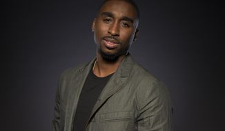 "In this June 5, 2017 photo, Demetrius Shipp Jr. poses for a portrait at the ""All Eyez on Me"" junket at the Four Seasons Hotel in Beverly Hills, Calif. Shipp portrays the late rapper Tupac Shakur, who was killed in 1996. (Photo by Ron Eshel/Invision/AP)"