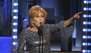 """Bette Midler accepts the award for best performance by an actress in a leading role in a musical for """"Hello, Dolly!"""" at the 71st annual Tony Awards on Sunday, June 11, 2017, in New York. (Photo by Michael Zorn/Invision/AP) ** FILE **"""