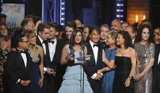 "Stacey Mindich, center, and the cast and crew of ""Dear Evan Hansen"" accept the award for best musical at the 71st annual Tony Awards on Sunday, June 11, 2017, in New York. (Photo by Michael Zorn/Invision/AP)"