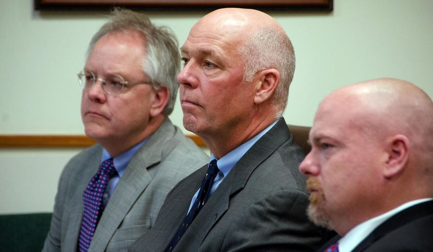 Congressman-elect Greg Gianforte, center, sits alongside William Mercer, left, and Todd Whipple Monday, June 12, 2017,  during his court hearing in Bozeman, Mont. Gianforte plead guilty to assaulting Ben Jacobs, a Guardian reporter, on the eve of the special election in Montana. (Freddy Monares/Bozeman Daily Chronicle via AP)