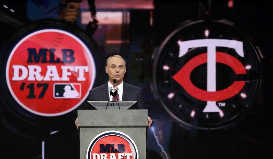 Commissioner Rob Manfred announces the Minnesota Twins selection of Royce Lewis, a shortstop and outfielder from JSerra Catholic High School in San Juan Capistrano, Calif., with the No. 1 pick in the first round of the Major League Baseball draft, Monday, June 12, 2017, in Secaucus, N.J. (AP Photo/Julio Cortez)