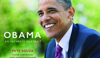 "This cover image released by  Little, Brown and Company shows ""Obama: An Intimate Portrait,"" by former White House photographer Pete Souza. ( Little, Brown and Company via AP)"