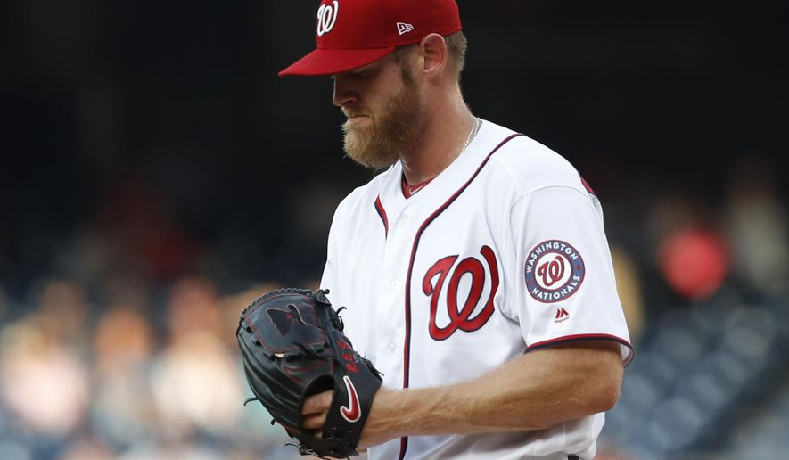 Washington Nationals starting pitcher Stephen Strasburg pauses during the first inning of a baseball game against the Atlanta Braves at Nationals Park, Monday, June 12, 2017, in Washington. Strasburg gave up three runs in the first inning. (AP Photo/Carolyn Kaster)