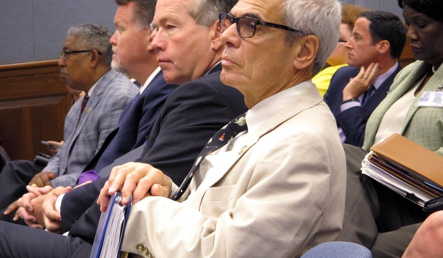 Commissioner of Higher Education Joe Rallo, right, and other public college system leaders listen to the budget debate in the House Appropriations Committee, on Monday, June 12, 2017, in Baton Rouge, La. (AP Photo/Melinda Deslatte)