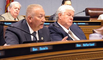 Rep. Jack McFarland, R-Winnfield, left asks questions about the state operating budget as Rep. Steve Pylant, R-Winnsboro, listens in the House Appropriations Committee, on Monday, June 12, 2017, in Baton Rouge, La. (AP Photo/Melinda Deslatte)