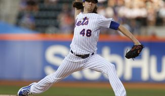 New York Mets starting Jacob deGrom delivers during the first inning of a baseball game against the Chicago Cubs, Monday, June 12, 2017, in New York. (AP Photo/Kathy Willens)