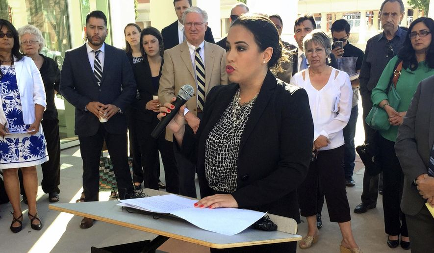 Marisa Bono, southwest regional counsel for the Mexican American Legal Defense and Educational Fund, outlines accusations that the state of New Mexico has failed to provide essential educational opportunities to all students, outside a state district courthouse in Santa Fe, N.M., Monday, June 12, 2017. Parents, school districts and advocacy groups allege that New Mexico's education system isn't meeting its responsibilities for Native American students, low-income students and those learning English as a second language. (AP Photo/Morgan Lee)