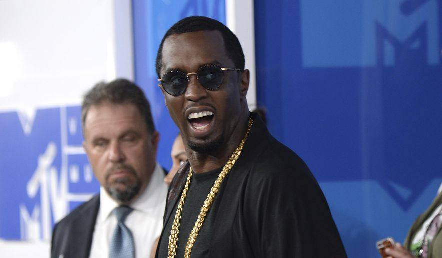 """FILE - In this  Aug. 28, 2016, file photo, Sean """"Diddy"""" Combs arrives at the MTV Video Music Awards at Madison Square Garden in New York. On June 12, 2017, Forbes named Combs the top earner its list of the 100 highest paid celebrities. (Photo by Evan Agostini/Invision/AP, File)"""