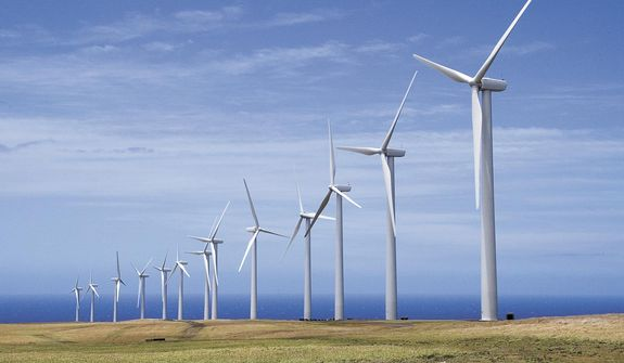 In this July 12, 2007, file photo, General Electric wind turbines, part of the Pakini Nui Wind Farm project are seen in Kailua-kona, Hawaii. (Michael Darden/West Hawaii Today via AP, File)
