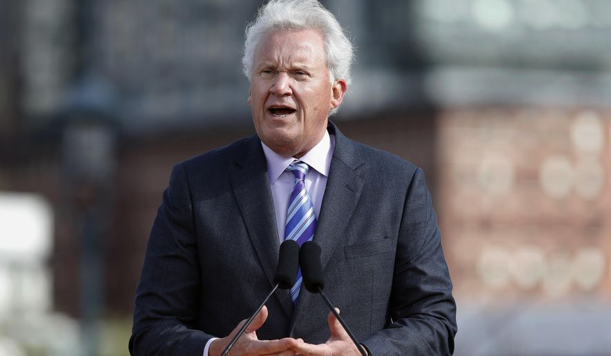 FILE - In this Monday, May 8, 2017, file photo, General Electric CEO Jeff Immelt speaks during a groundbreaking ceremony at the site of GE's new headquarters, in Boston. General Electric said Immelt is stepping down as CEO. John Flannery, president and CEO of the conglomerate's health care unit, will take over the post in August. (AP Photo/Michael Dwyer, File)
