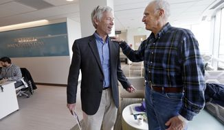 "In this photo taken March 29, 2017, Dr. David Maloney of the Fred Hutchinson Cancer Research Center is greeted by patient Ken Shefveland, whose lymphoma was successfully treated with CAR-T cell therapy. Immune therapy is the hottest trend in cancer care and its next frontier is creating ""living drugs"" that grow inside the body into an army that seeks and destroys tumors.   (AP Photo/Elaine Thompson)"