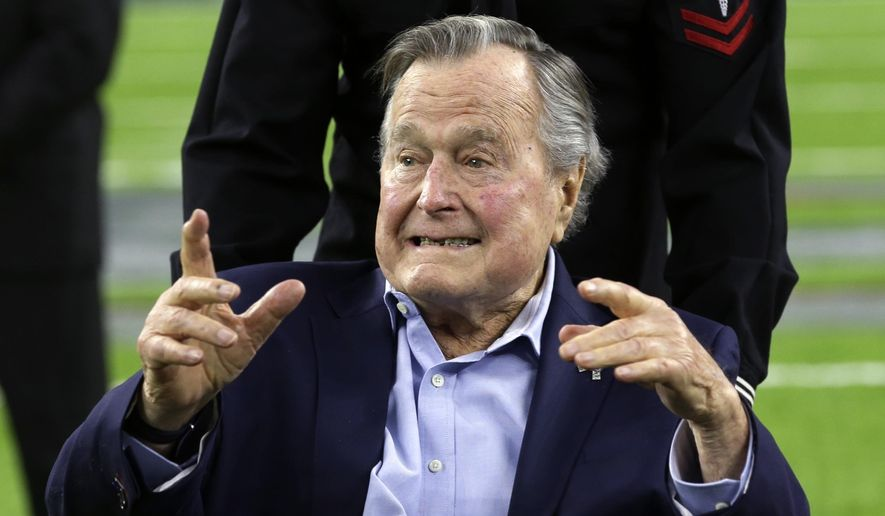 In this Feb. 5, 2017, file photo, former President George H.W. Bush arrives on the field for a coin toss before the NFL Super Bowl 51 football game between the Atlanta Falcons and the New England Patriots in Houston. (AP Photo/Eric Gay, File)