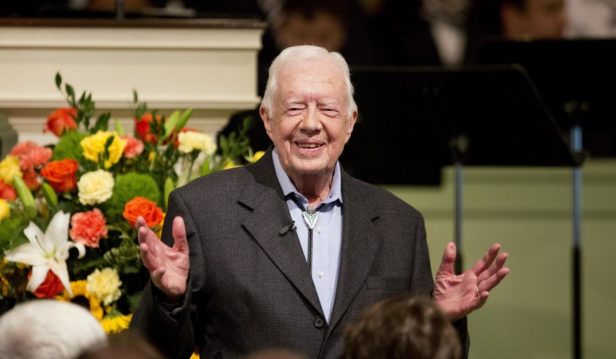 FILE - In this Aug. 23, 2015, file photo, former President Jimmy Carter teaches Sunday School class at Maranatha Baptist Church in his hometown in Plains, Ga. Video posted online on June 8, 2017, shows Carter shaking the hand of every passenger aboard a recent commercial flight from Atlanta to Washington.. (AP Photo/David Goldman, File)