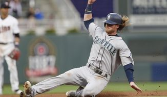 Seattle Mariners' Ben Gamel slides safely into third base as he advances from first on a hit by Mitch Haniger in the fourth inning of a baseball game against the Minnesota Twins, Monday, June 12, 2017, in Minneapolis. (AP Photo/Jim Mone)