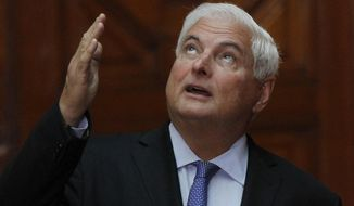 FILE.- In this March 24, 2017 file photo, Panama's President Ricardo Martinelli gestures during a meeting with Mexico's President Enrique Pena Nieto in Mexico City, Monday, March 24, 2014.  U.S. authorities have arrested Monday June 12, 2017 former Panamanian President Ricardo Martinelli on an extradition warrant from his country. U.S. Marshals Service spokesman Manny Puri says Martinelli was in custody Monday evening at a federal detention center in Miami. He is accused of corruption and spying on opponents in Panama. (AP Photo/Marco Ugarte, File)