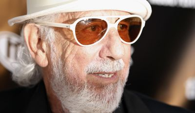 "ADVANCE FOR USE TUESDAY, JUNE 13, 2017 AND THEREAFTER-FILE - In this June 26, 2008 file photo, Lou Adler arrives at Sunset Strip Music Festival opening night tribute event in Los Angeles. Fifty years ago in June 2017, the three-day Monterey Pop concert in the San Francisco Bay area gave birth to the ""Summer of Love'' and paved the way for today's popular festivals. ""The focus was the music and how to present it in the best possible way,'' Adler said recently. (AP Photo/Matt Sayles, File)"