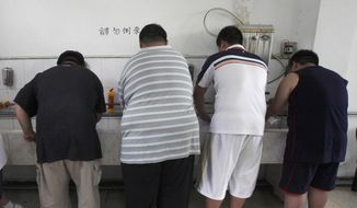 In this Thursday, July 24, 2008, file photo, obese patients wash their plates after lunch at the Aimin Fat Reduction Hospital in Tianjin, China. The hospital uses a combination of diet, exercise and traditional Chinese acupuncture to treat rising obesity rates. Research released Monday, June 12, 2017, found the obesity epidemic is getting worse in most parts of the world, according to data between 1980 and 2015. (AP Photo/Ng Han Guan)