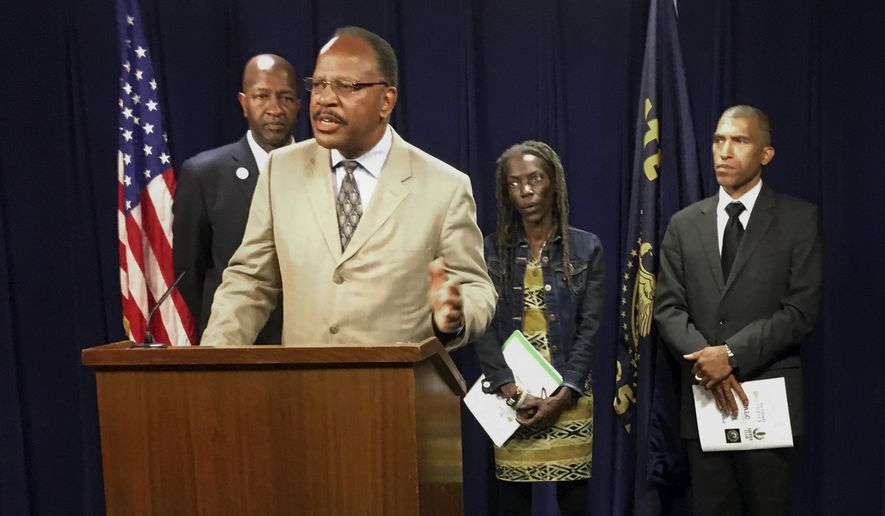 Presidents of the four branches in Oregon of the NAACP from left, Frederick Edwards, Corvallis branch; Benny Williams, at podium Salem-Keiser branch; Jo Anne Hardesty, Portland branch; and Eric Richardson, Eugene-Springfield branch attend a news conference Monday, June 12, 2017, at the state Capitol in Salem, Ore. The four came to State Capitol to support several bills, including one designed to end racial profiling by police, and to release a report that urges greater inclusiveness of minorities as the state turns to renewable energy. (AP Photo/Andrew Selsky)