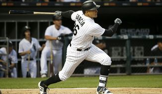 Chicago White Sox's Avisail Garcia hits an RBI double off Baltimore Orioles starting pitcher Wade Miley during the third inning of a baseball game, Monday, June 12, 2017, in Chicago. (AP Photo/Charles Rex Arbogast)