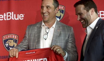 Florida Panthers' new coach Bob Boughner shares a laugh with Panthers President & CEO Matthew Caldwell Monday, June 12, 2017, in Sunrise, Fla.  (Taimy Alvarez/South Florida Sun-Sentinel via AP)