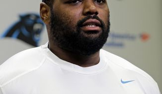 FILE - In this April 20, 2015, file photo, Carolina Panthers' Michael Oher speaks to the media during the first day of their NFL football offseason conditioning program in Charlotte, N.C. Oher's future in Carolina remains cloudy as the Panthers prepare for their mandatory three-day minicamp beginning Tuesday, June 13, 2017. (AP Photo/Chuck Burton, File)