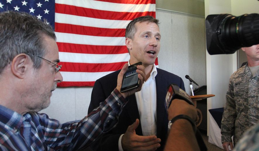 Missouri Gov. Eric Greitens speaks to reporters after signing a bill Monday, June, 12, 2017 in Knob Noster, Mo. The bill is aimed at averting a scenario in which Missouri residents could have been turned away at airports for lack of valid identification. The legislation will give residents the option to get driver's licenses or other identification cards that comply with the federal Real ID Act. (Jack Miles/Daily Star-Journal via AP)