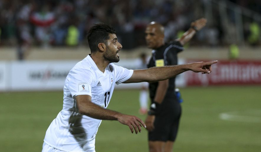 Iran's Mehdi Taremi celebrates after scoring a goal against Uzbekistan during their Asia Group A, 2018 World Cup qualifying soccer match at the Azadi Stadium in Tehran, Iran, Monday, June 12, 2017. Iran became the second team to qualify for the 2018 World Cup by beating Uzbekistan 2-0. (AP Photo/Vahid Salemi)