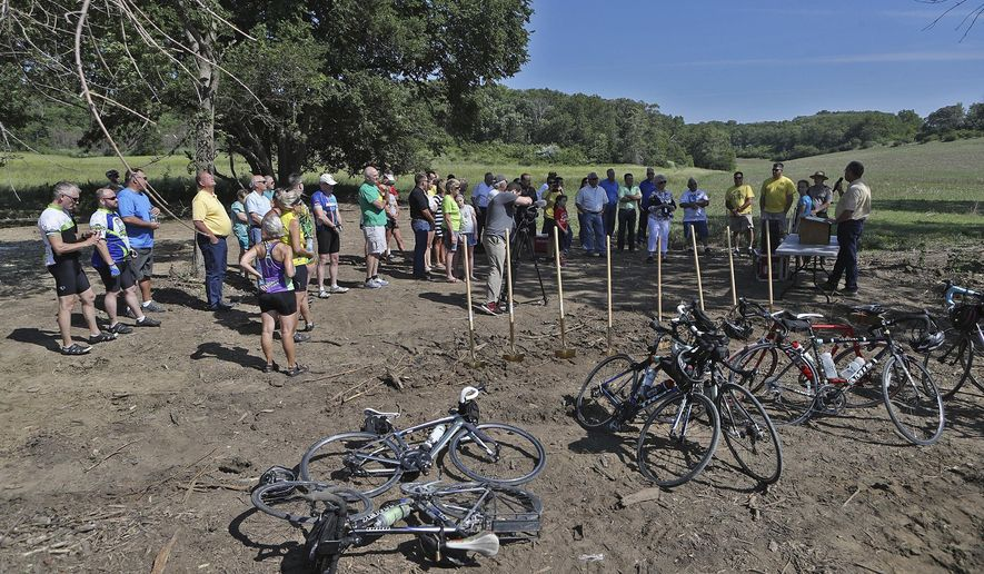 A groundbreaking ceremony for a multi-use trail connecting Council Bluffs and Neola is held at the Smith Wildlife Area on Railroad Avenue near County Road L34 on Saturday, June 10.  (Joe Shearer /The Daily Nonpareil via AP)