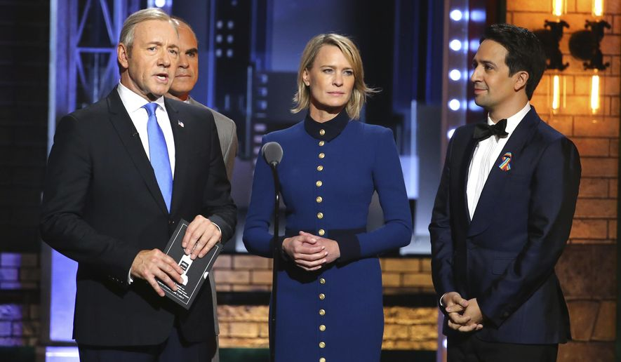 """Kevin Spacey, from left, Michael Kelly and Robin Wright appear as their characters from """"House of Cards"""" as they present Lin-Manuel Miranda with the envelope for best musical at the 71st annual Tony Awards on Sunday, June 11, 2017, in New York. (Photo by Michael Zorn/Invision/AP)"""
