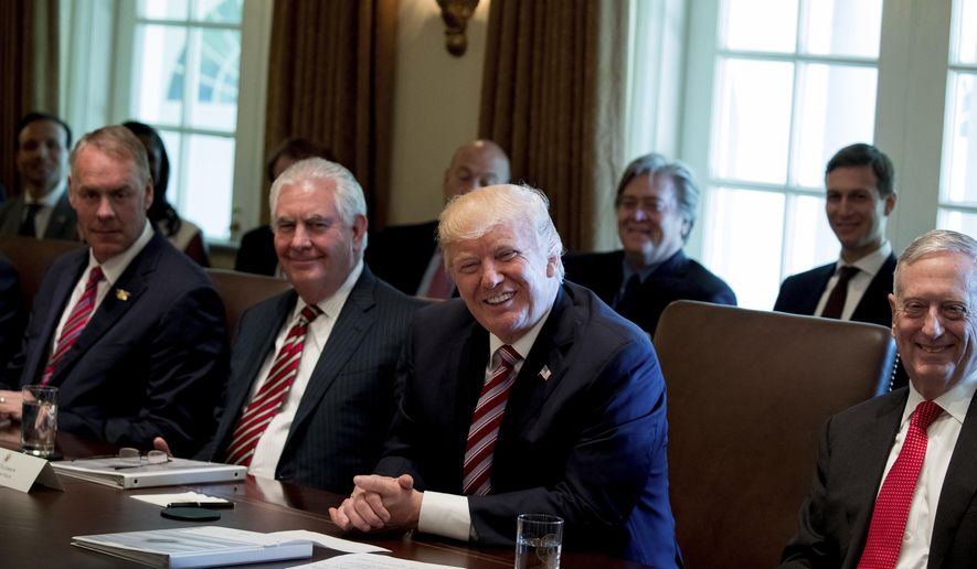 President Donald Trump, accompanied by, from left, Interior Secretary Ryan Zinke, Secretary of State Rex Tillerson Defense Secretary Jim Mattis, smile during a Cabinet meeting, Monday, June 12, 2017, in the Cabinet Room of the White House in Washington. (AP Photo/Andrew Harnik)