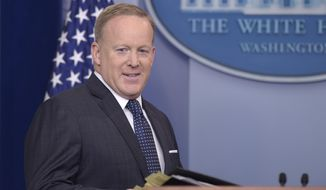 White House press secretary Sean Spicer arrives for the daily briefing at the White House in Washington, Monday, June 12, 2017. (AP Photo/Susan Walsh)