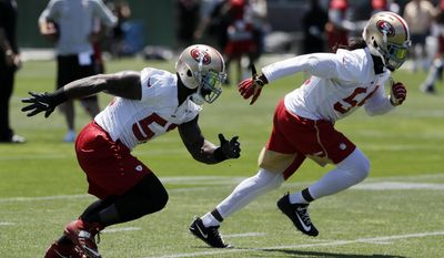 San Francisco 49ers' NaVorro Bowman, left, and Ray-Ray Armstrong go through drills during NFL football practice at the team's training facility Tuesday, June 13, 2017, in Santa Clara, Calif. (AP Photo/Marcio Jose Sanchez)