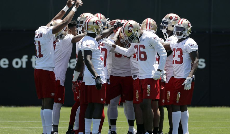San Francisco 49ers players huddle during NFL football practice at the team's training facility Tuesday, June 13, 2017, in Santa Clara, Calif. (AP Photo/Marcio Jose Sanchez)