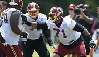 Washington Redskins tackle Trent Williams (71) runs through a drill during NFL football team practice, Tuesday, June 13, 2017, in Ashburn, Va. (AP Photo/Nick Wass)