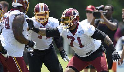 Washington Redskins tackle Trent Williams (71) runs through a drill during NFL football team practice, Tuesday, June 13, 2017, in Ashburn, Va. (AP Photo/Nick Wass)