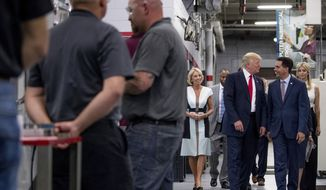 President Donald Trump laughs with Wisconsin Gov. Scott Walker, second from right as he tours Waukesha County Technical College in Pewaukee, Wis., Tuesday, June 13, 2017. Also pictured is Education Secretary Betsy DeVos, left, and Ivanka Trump, the daughter of President Donald Trump, right. (AP Photo/Andrew Harnik)