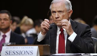 Attorney General Jeff Sessions takes off his glasses while testifying on Capitol Hill in Washington, Tuesday, June 13, 2017, before the Senate Intelligence Committee hearingabout his role in the firing of James Comey, his Russian contacts during the campaign and his decision to recuse from an investigation into possible ties between Moscow and associates of President Donald Trump. (AP Photo/Jacquelyn Martin)