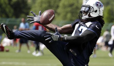 Tennessee Titans safety Johnathan Cyprien catches a pass during NFL football minicamp Tuesday, June 13, 2017, in Nashville, Tenn. (AP Photo/Mark Humphrey)