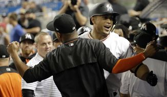 Miami Marlins' Giancarlo Stanton celebrates after hitting a two-run home run during the fifth inning of an interleague baseball game against the Oakland Athletics, Tuesday, June 13, 2017, in Miami. (AP Photo/Lynne Sladky)