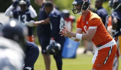 Chicago Bears quarterback Mike Glennon, right, works with teammates during the NFL football team's minicamp at Halas Hall, Tuesday, June 13, 2017, in Lake Forest, Ill. (AP Photo/Nam Y. Huh)
