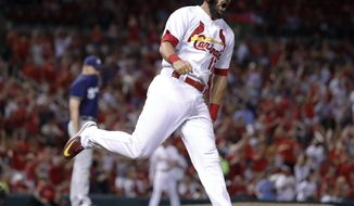 St. Louis Cardinals' Matt Carpenter celebrates as he rounds the bases after hitting a solo home run off Milwaukee Brewers relief pitcher Jared Hughes during the seventh inning in the second game of a baseball doubleheader Tuesday, June 13, 2017, in St. Louis. (AP Photo/Jeff Roberson)