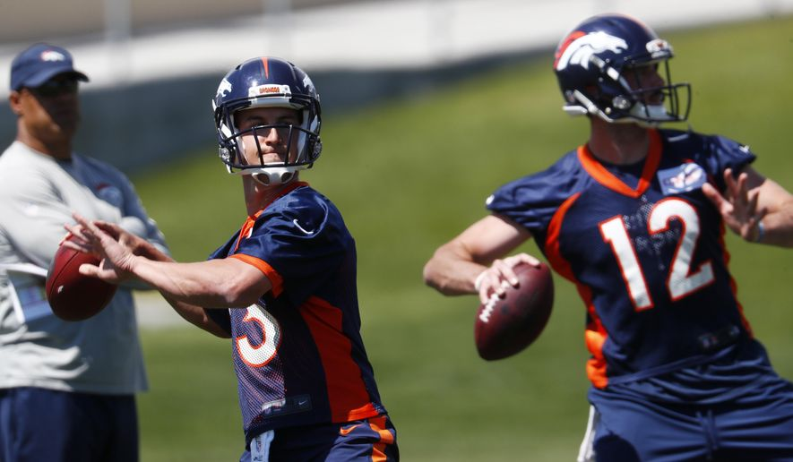 FILE - In this Monday, June 5, 2017, file photo, Denver Broncos quarterback Trevor Siemian, left, throws along with quarterback Paxton Lynch during the team's NFL football minicamp session in Englewood, Colo. (AP Photo/David Zalubowski)