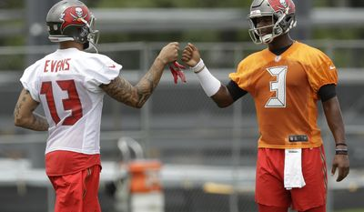 Tampa Bay Buccaneers quarterback Jameis Winston (3) fist bumps wide receiver Mike Evans (13) during NFL football minicamp Tuesday, June 13, 2017, in Tampa, Fla. (AP Photo/Chris O'Meara)