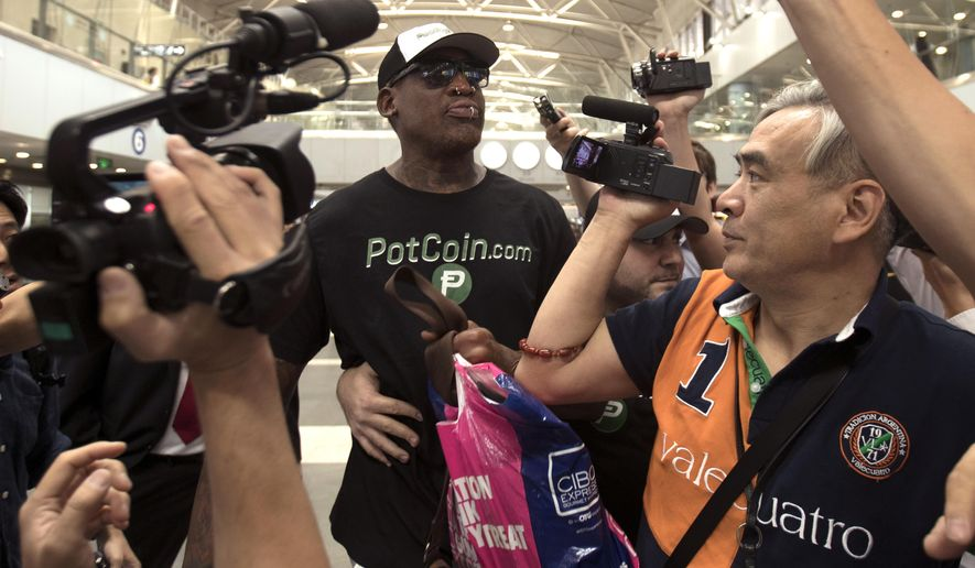 Former NBA basketball player Dennis Rodman, center, arrives at Beijing Capital International Airport in Beijing, Tuesday, June 13, 2017. North Korea is expecting another visit by Rodman on Tuesday in what would be his first to the country since President Donald Trump took office. (AP Photo/Mark Schiefelbein)