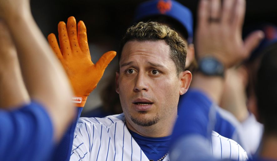 New York Mets' Asdrubal Cabrera celebrates with teammates after hitting a home run in the fourth inning of a baseball game against the Chicago Cubs, Monday, June 12, 2017, in New York. (AP Photo/Kathy Willens)