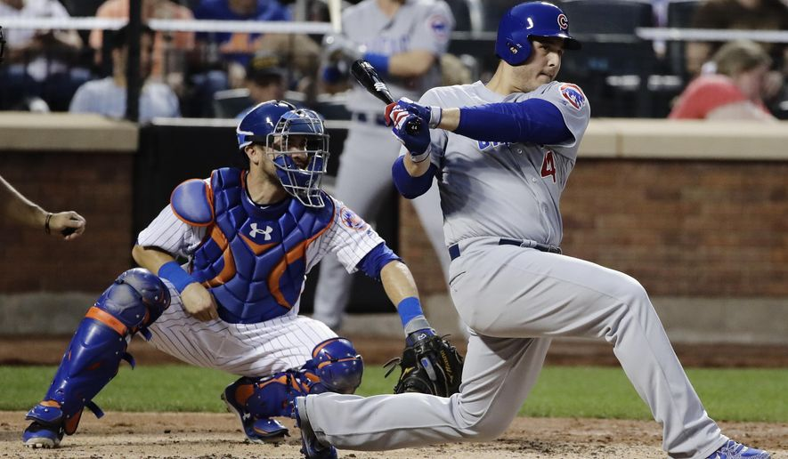 Chicago Cubs' Anthony Rizzo (44) follows through on an hits an RBI double as New York Mets catcher Travis d'Arnaud watches during the third inning of a baseball game Tuesday, June 13, 2017, in New York. (AP Photo/Frank Franklin II)