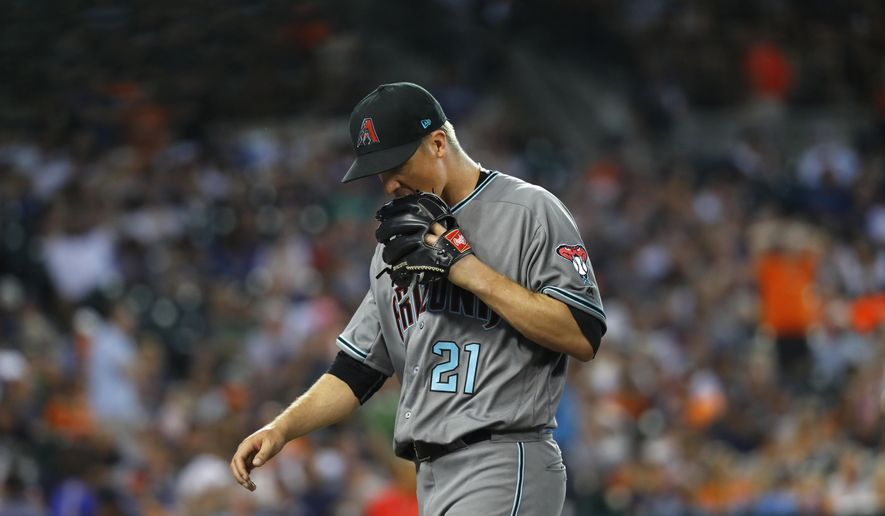 Arizona Diamondbacks pitcher Zack Greinke walks to the bench against the Detroit Tigers in the sixth inning of a baseball game in Detroit, Tuesday, June 13, 2017. (AP Photo/Paul Sancya)