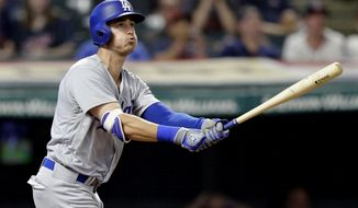Los Angeles Dodgers' Cody Bellinger watches his three-run home run off Cleveland Indians relief pitcher Boone Logan during the ninth inning of a baseball game, Tuesday, June 13, 2017, in Cleveland. (AP Photo/Tony Dejak)